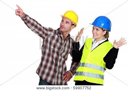 Construction worker pointing out a problem while his co-worker denies any involvement