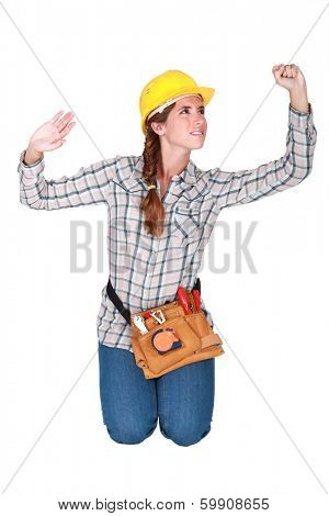 Tradeswoman confined by a transparent wall