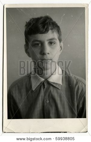 KURSK, USSR - CIRCA 1970s:  An antique photo shows  portrait of a 14-15 years old teenager boy.
