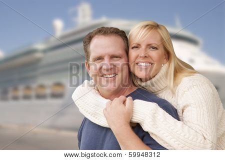 Young Happy Couple Hugging On The Dock In Front of a Cruise Ship.