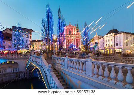 Romantic Ljubljana's city center decorated for Christmas time. River Ljubljanica Triple Bridge (Tromostovje) and Preseren's square; Ljubljana Slovenia Europe. poster