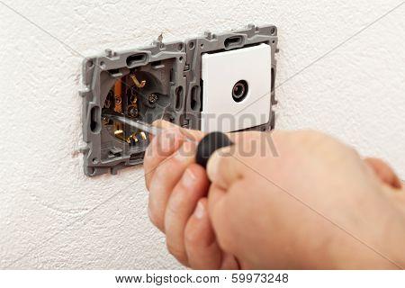 Electician Hands Installing Electical Wall Sockets