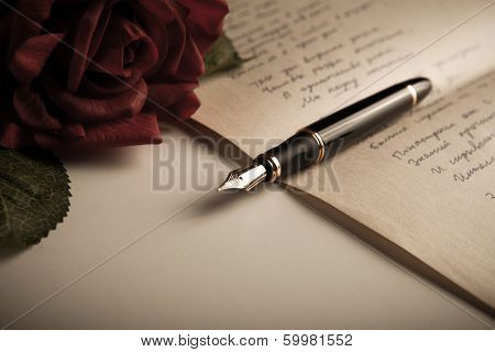 Fountain Pen On Text Sheet Paper With Rose