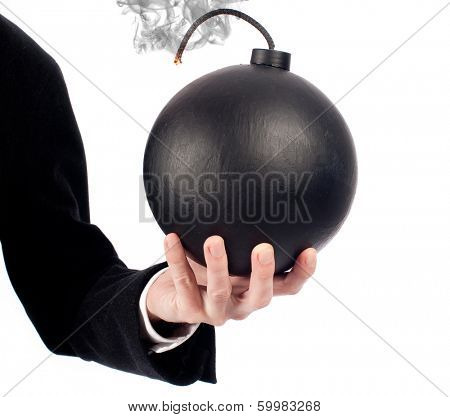 businessman hand holding an old-fashioned bomb on a white background