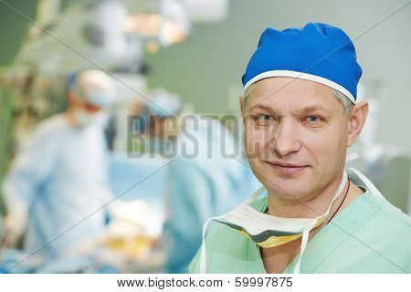 Male surgeon in uniform in front of cardiac surgery operation room at clinic poster