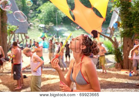 Ozora, Hungary - August 01: Girl Blowing Bubles On Ozora Festival, One Of The Greatest Psychedelic M