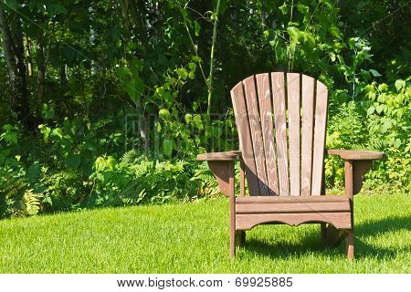 Summer Lawn Chair Outside On The Green Grass