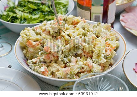 A Salad Bowl With Russian Salad (olivier) On A Festive Table