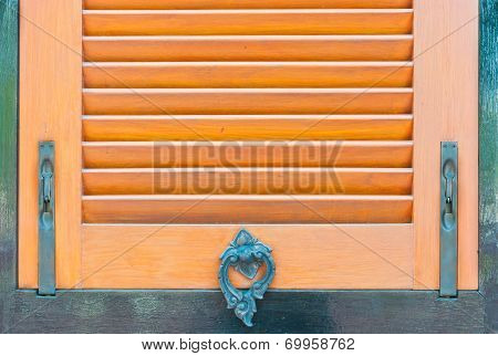 The metal handle in Thai style for wooden window as background poster