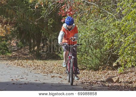 Bicyclist Texting On A Cell Phone