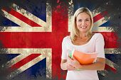 Mature student smiling against union jack flag in grunge effect poster