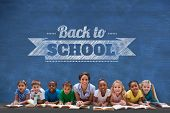 Cute pupils smiling at camera with teacher against blue chalkboard with back to school message poster
