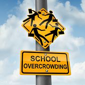 School overcrowding and classroom overcrowding concept as a crossing traffic sign with overcrowded students bursting out of the seams as a symbol of the problems of public education financing and lack of teachers. poster