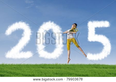 Girl Dancing To Celebrate New Year Outdoors