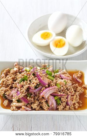 Thai traditonal food spicy minced chicken salad and vegetable