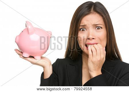 Money stress - business woman holding piggy bank. Debt, bankruptcy and savings concepts with stressed female businesswoman biting nails nervous isolated poster