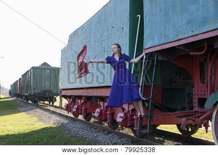 Woman At Dress Waving A Scarf Down