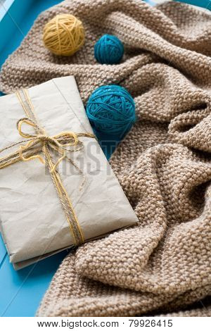 A Gift To Lie Next To The Coil Bright Filaments And Blanket Knitted On Blue Background