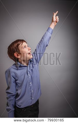 on gray background boy raised his hand up