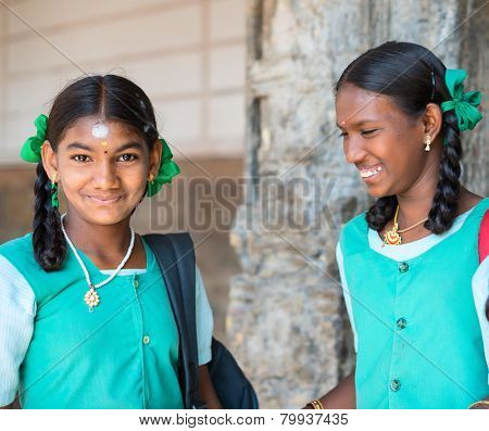 Madurai, India - February 16: An Unidentified Smiling Girl In School Uniform Are Standing In Sri Mee