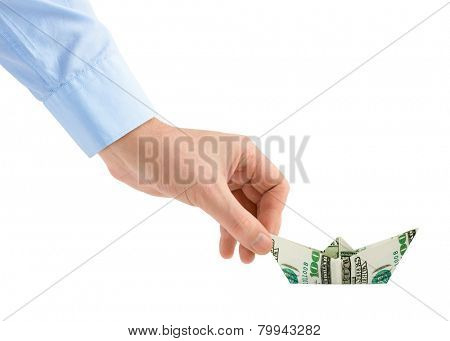 Hand with money ship isolated on white background