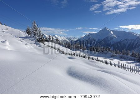 wooden fence at winter landscape
