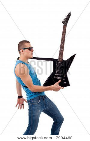 Guitarist Holding His Guitar In One Hand