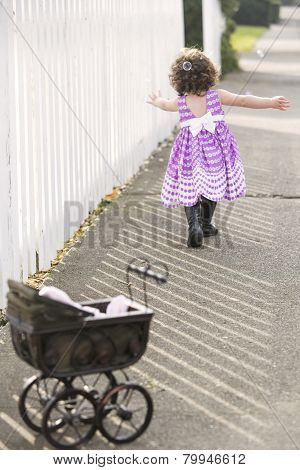 Little Girl In Pink Dress Chasing Soap Bubbles