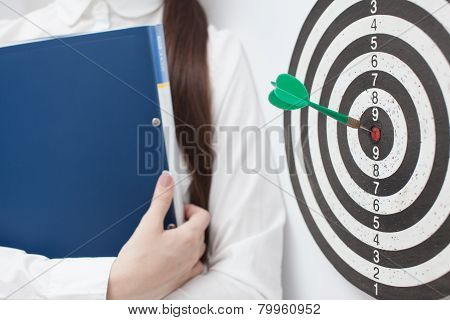 Businesswoman and good result. Goal concept. Bullseye poster