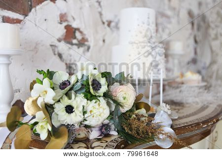 Wedding Cake With Silver Decoration And Wedding Bouquet With Ranunculus