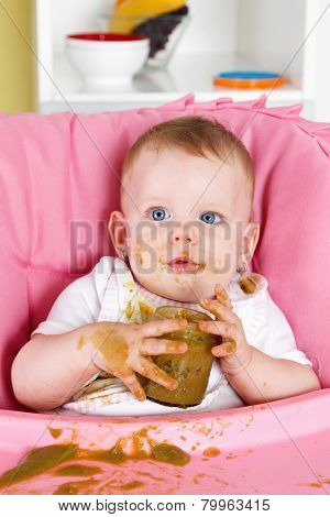 Baby making a mess while eating