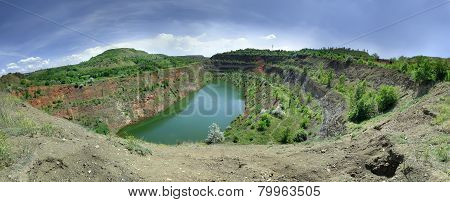 view of the flooded quarry in Krivoy Rog Ukraine poster