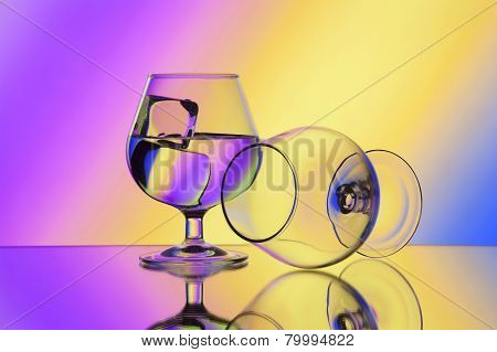 Two Wineglases On Gradient Background