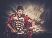 Legionary soldier against stormy sky poster