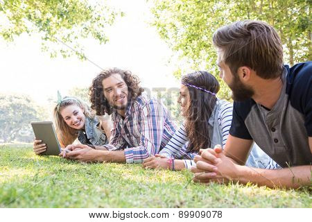 Classmates revising together on campus on a summers day poster