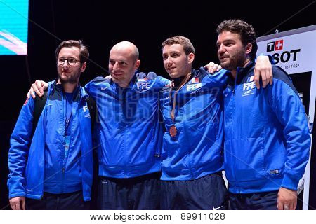 ST. PETERSBURG, RUSSIA - MAY 2, 2015: Bronze medalist of  the stage of FIE World Cup, International fencing tournament St. Petersburg Foil Vincent Simon of France with his coaches after award ceremony