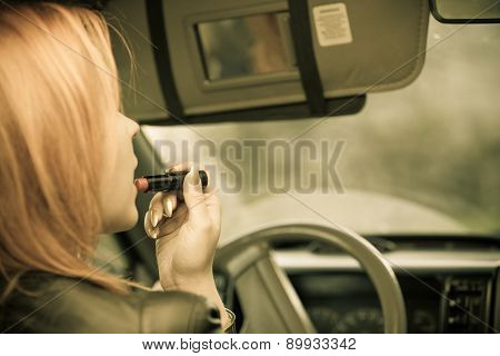 Girl Painting Her Lips Doing Make Up While Driving The Car.