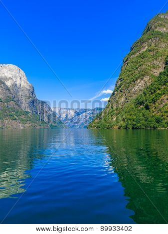 Tourism vacation and travel. Mountains and fjord Sognefjord in Norway Scandinavia. poster