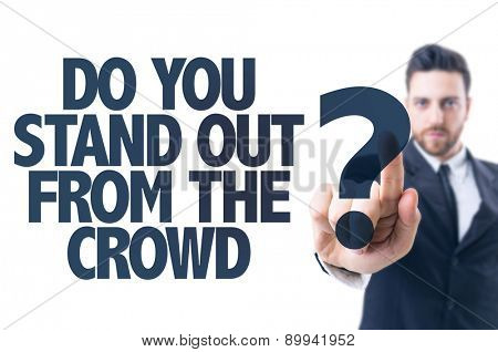 Business man pointing the text: Do You Stand Out from the Crowd?