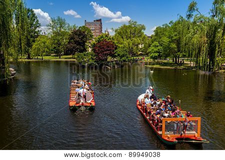 Locals And Tourists Enjoying A Ride On The Famous Swan Boats In Boston