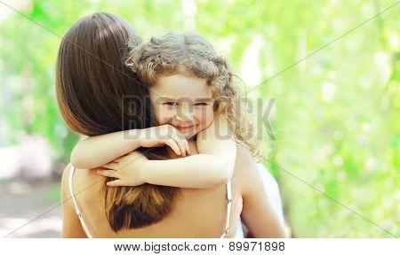 Mother's Day, Family, Childhood And People Concept - Happy Daughter Hugging Mother In Warm Sunny Sum