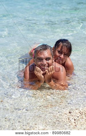Portrait of cheerful couple in tropical sea
