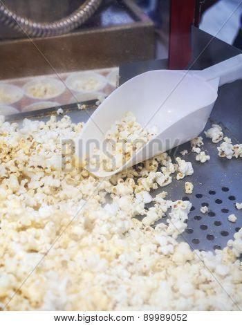 Pop corn with spoon in popcorn machine for sell