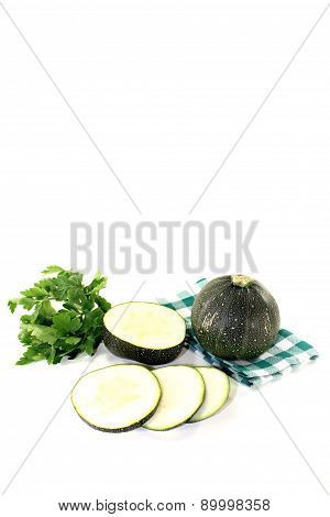 Rotund Raw Zucchini On A Green Napkin