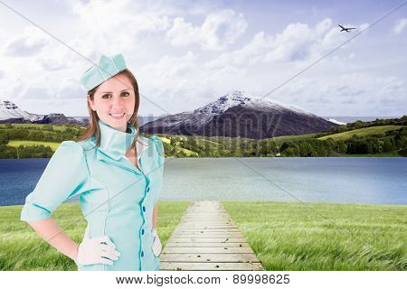 Air hostess against scenic backdrop poster