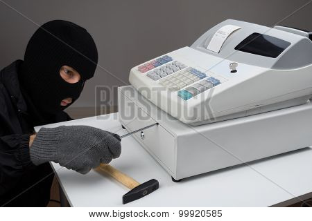Thief Opening Cash Register Drawer