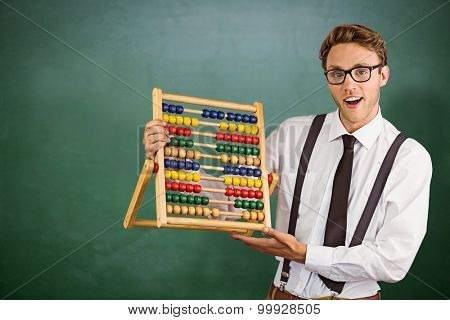 Geeky businessman using an abacus against green chalkboard poster