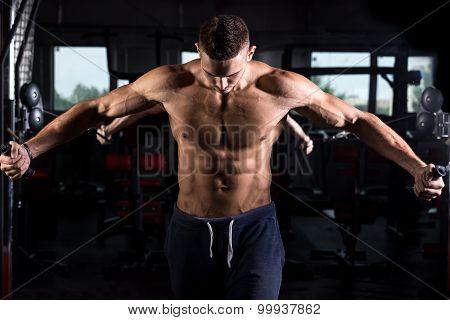 Young Bodybuilder Using Fitness Equipment