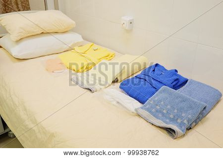 Clean hospitel dress on the bed in a ward