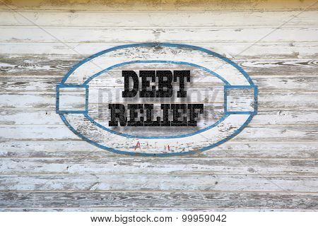 Debt Relief message on shed side